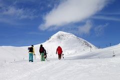 Three snowboarder on slope at sun nice day Royalty Free Stock Images