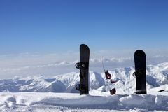 Three snowboards in snow near off-piste slope in sun day Stock Photo