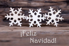 Three Snowflakes with Feliz Navidad. Three Snowflakes with the Spanish Words Feliz Navidad which means Merry Christmas stock images