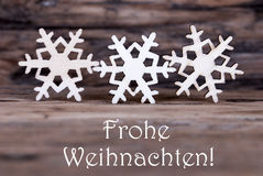 Three Snowflakes with Frohe Weihnachten Royalty Free Stock Photography