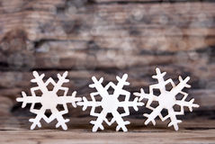 Three Snowflakes on Wood III Royalty Free Stock Photography
