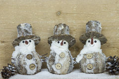 Three snowman with pine cones Stock Photo