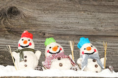 Three snowmen. Christmas background Funny color snowmen Stock Image