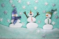 Free Three Snowmen Enjoying The Snow Stock Photo - 129527640