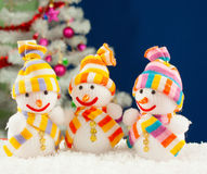 Three snowmen in front of the evergreen tree Royalty Free Stock Photography