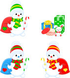 Three snowmen and gifts Royalty Free Stock Images