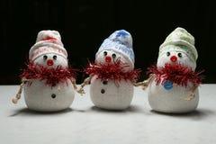 Three snowmen Stock Photography