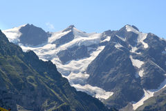 Three snowy peaks of the Swiss Bernese Oberland Stock Photo