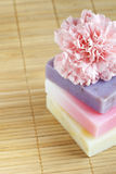 Three soap bars and flower Stock Image