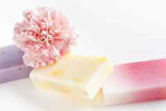 Three soap bars and flower Royalty Free Stock Photos