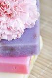 Three soap bars and flower macro Stock Photography