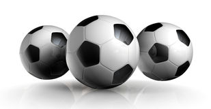 Three Soccer Balls. Three Rendered soccer balls placed on a reflective white background Stock Images