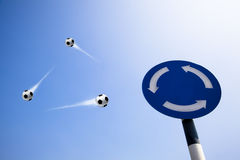 Three soccer balls fly into sky Stock Images