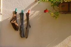 Coloured  socks on the sun Stock Photos