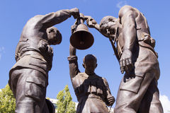 Three soldiers with the bell. Volgograd, Russia Royalty Free Stock Photography