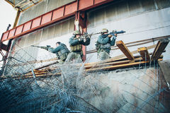 Three soldiers freed the building from enemy. Three rangers freed the building from enemy Royalty Free Stock Photography