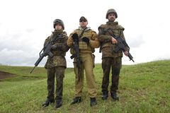 Three soldiers outdoors posing Royalty Free Stock Photography