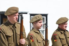 Three soldiers on parade in reenactment Royalty Free Stock Image