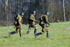 Three soldiers running. Moscow battle historical reenactment Royalty Free Stock Images