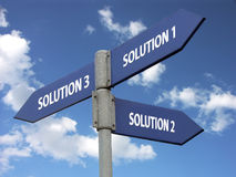 Three solutions. Metal signpost indicating three solutions against blue sky Royalty Free Stock Images