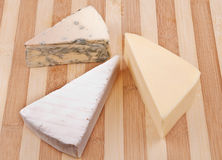 Three sort of cheese. Arranged on a wooden tray stock image