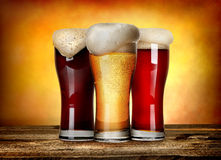 Three sorts of beer. On a wooden table royalty free stock images
