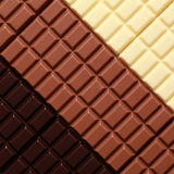 Three sorts of chocolate. 3 different sorts of chocolate in a row stock images