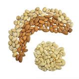 Three sorts of nuts. Wave of nuts around nuts royalty free stock photography