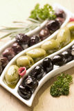 Three sorts of olives Stock Photos