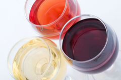 Three sorts of wine. In glasses - red, rose and white Royalty Free Stock Photography