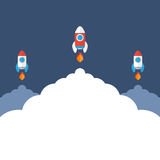 Three space rockets is flying up. Start Up concept symbol. Stock Photography