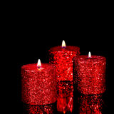 Three spangled candles in the dark Royalty Free Stock Images
