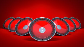 Three speakers are on a red background. Stock Photography