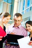 Three specialists at work Royalty Free Stock Photo