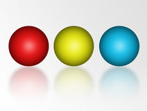 Three sphere. Red, yellow and blue sphere over white background Royalty Free Stock Photography