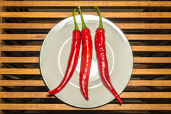 Three spicy chilli peppers Royalty Free Stock Photo