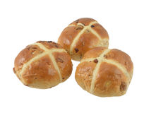 Three Spicy Hot Cross Buns Isolated. Three Spicy Easter Hot Cross Buns isolated on white background Royalty Free Stock Images