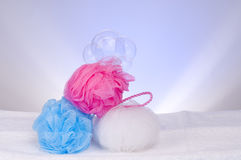 Three sponges and soap bubbles Royalty Free Stock Photos