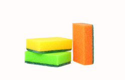 Three sponges for washing dishes, standing upright. Two lie horizontally, one vertically standing Royalty Free Stock Photos