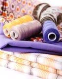Three Spools Of Colored Thread Stock Photos