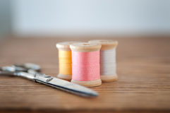 Three Spools of Thread and Scissors Royalty Free Stock Images