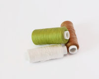 Three spools of thread Stock Photos