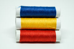 Three spools of thread Stock Photography