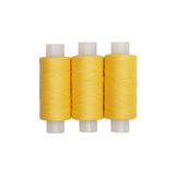Three spools of yellow thread Royalty Free Stock Images