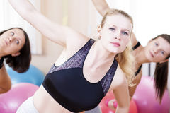 Three Sportive Caucasian Active Women Doing Stretching Exercises Stock Images
