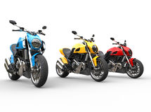 Three sports motorcycles in a row - studio shot Royalty Free Stock Images