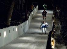 Three sportsmen skate downhill Stock Photography