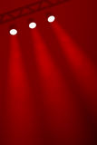 Three spotlights on a rich red smoky background Stock Photos