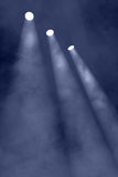 Three spotlights through smokey haze Stock Photos
