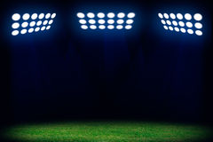 Three spotlights on soccer field. Sport abstract background with copy space Royalty Free Stock Images